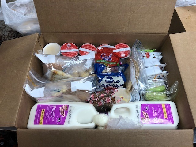 Box of food with half gallons of milk