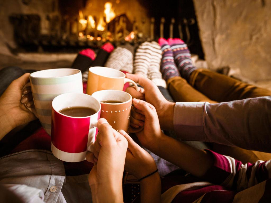 Family holding hot cocoa