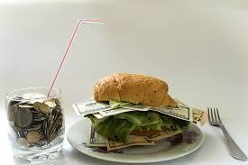Money sandwich and cup with change