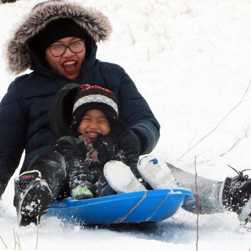 Parent and child sledding