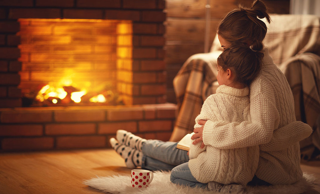 Mother and child by fireplace