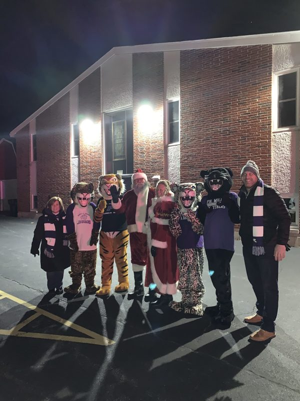 School Mascots Take Part in Rockin' Christmas Festivities